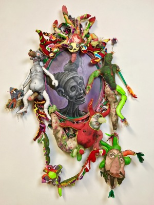 """Reflection of a Harsh Super Ego"" 2017 Mixed media: acrylic painted recycled rag, embroidery floss, feathers, IKEA mirror, poly-fill. 50 by 32 by 6 inches."
