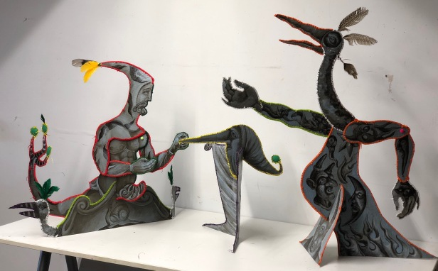 """The Siren & the Machiavels"" 2018 Recycled cardboard, acrylic paint, embroidery floss, reclaimed feathers. Each figure approx: 26 by 32 inches."